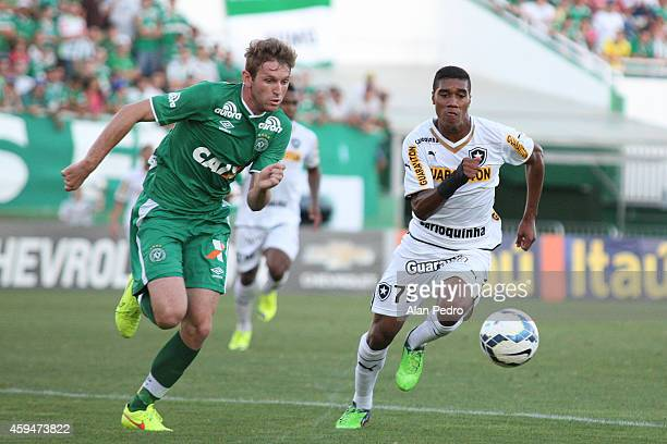 Fabiano of Chapecoense struggles for the ball with a Murilo of Botafogo during a match between Chapecoense and Botafogo for the Brazilian Series A...