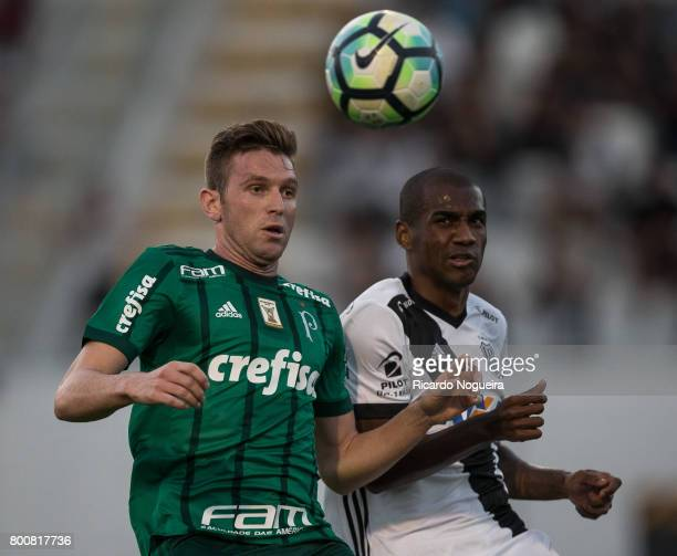 Fabiano of Palmeiras battles for the ball with Marllon of Ponte Preta during the match between Ponte Preta and Palmeiras as a part of Campeonato...