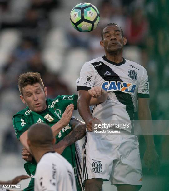 Fabiano of Palmeiras battles for the ball with Rodrigo of Ponte Preta during the match between Ponte Preta and Palmeiras as a part of Campeonato...