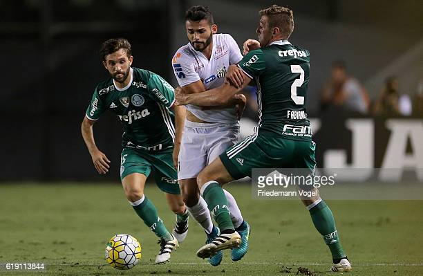 Fabiano of Palmeiras fights for the ball with Thiago Maia of Santos during the match between Santos and Palmeiras for the Brazilian Series A 2016 at...