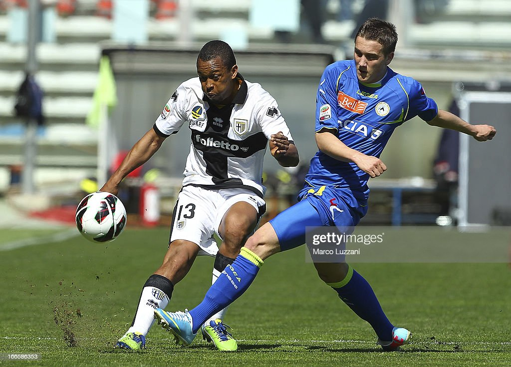 Fabiano Santacroce of Parma FC competes for the ball with Piotr Zielinski of Udinese Calcio during the Serie A match between Parma FC and Udinese Calcio at Stadio Ennio Tardini on April 14, 2013 in Parma, Italy.