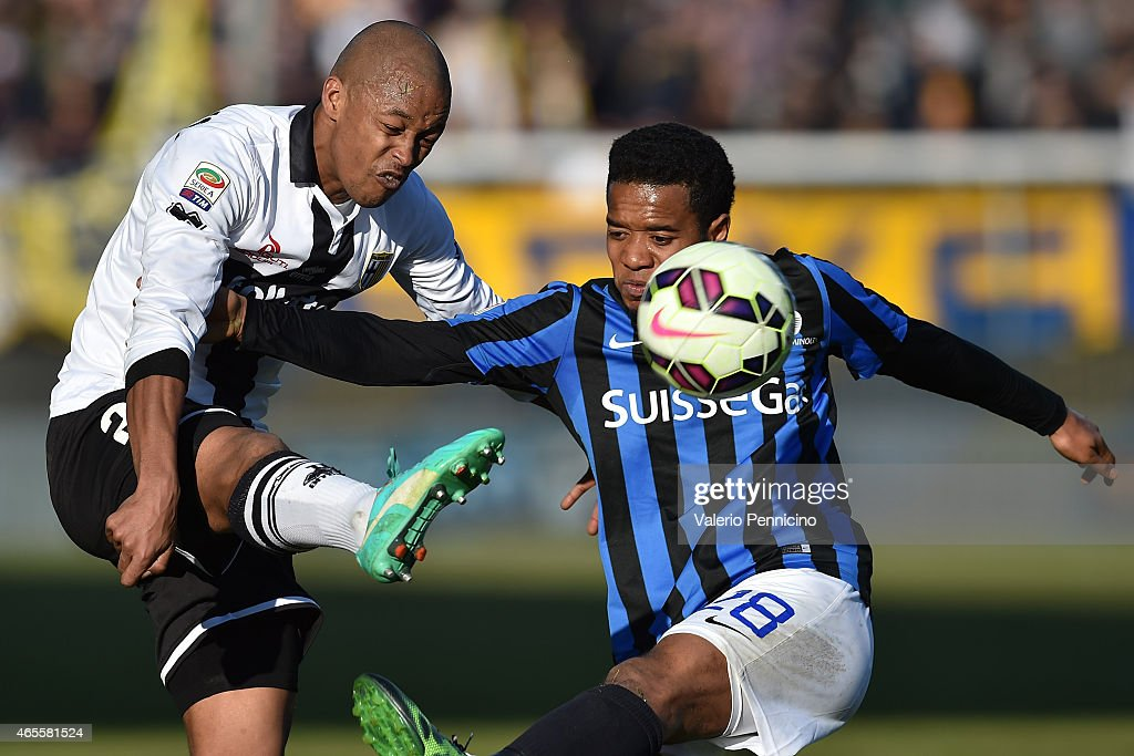 Fabiano Santacroce of Parma FC is challenged by Urby Emanuelson of Atalanta BC during the Serie A match between Parma FC and Atalanta BC at Stadio...