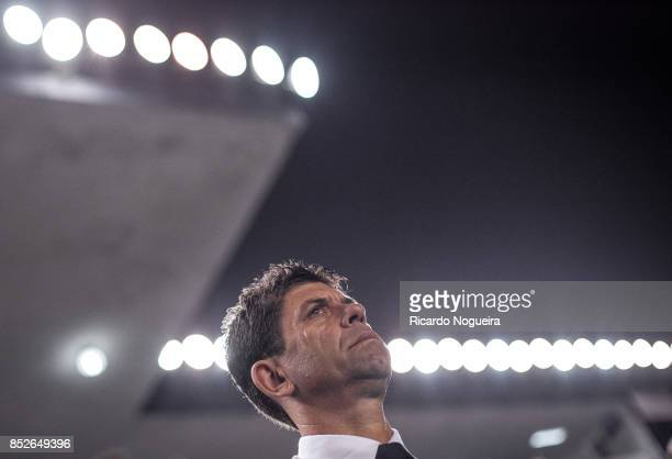 Fabiano Soares headcoach of Atletico Paranaense during the national anthem prior before the match between Santos and Atletico Paranaense as a part of...