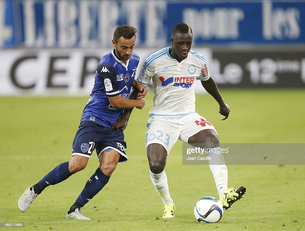 Fabien Camus of Troyes and <a gi-track='captionPersonalityLinkClicked' href=/galleries/search?phrase=Benjamin+Mendy&family=editorial&specificpeople=7029850 ng-click='$event.stopPropagation()'>Benjamin Mendy</a> of OM in action during the French Ligue 1 match between Olympique de Marseille (OM) and Troyes ESTAC at New Stade Velodrome on August 23, 2015 in Marseille, France.