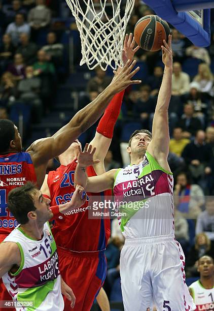 Fabien Causeur #5 of Laboral Kutxa Vitoria competes with Andrey Vorontsevich #20 of CSKA Moscow in action during the Euroleague Basketball Top 16...