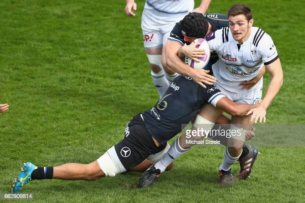 Fabien Sanconnie of Brive is tackled by Zach Mercer and Charlie Ewels of Bath during the European Rugby Challenge Cup Quarter Final match between...