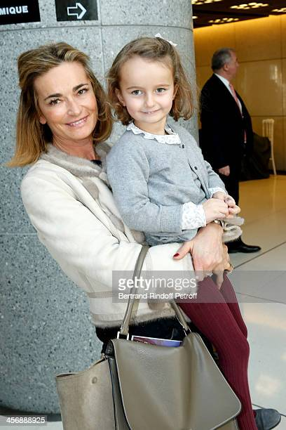 Fabienne Bazire and her grandniece Prune Achcar attend the 'Reves d'Enfants' Arop charity event at Opera Bastille on December 15 2013 in Paris France