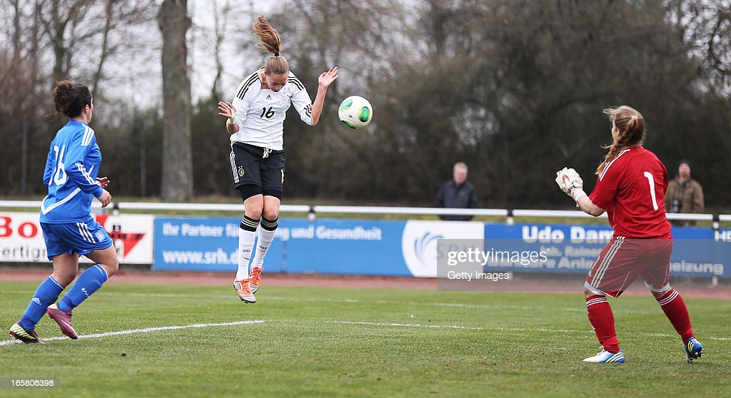 Fabienne Dongus (C) of Germany scores her team's seventh goal against goalkeeper Anthi Papakonstantinou of Greece during the Women's UEFA U19 Euro Qualification match between U19 Germany and U19 Greece at Sportzentrum Sued on April 6, 2013 in Kirchheim, Germany.