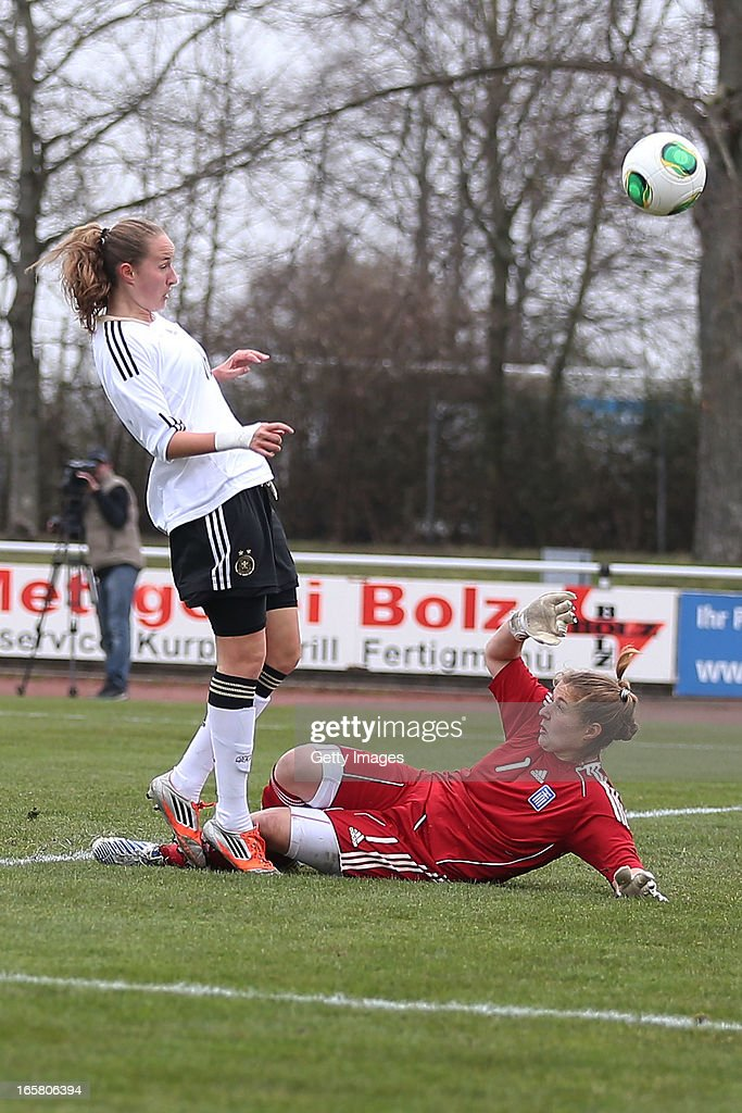 Fabienne Dongus (L) of Germany scores their sixth goal against goalkeeper Anthi Papakonstantinou of Greece during the Women's UEFA U19 Euro Qualification match between U19 Germany and U19 Greece at Sportzentrum Sued on April 6, 2013 in Kirchheim, Germany.
