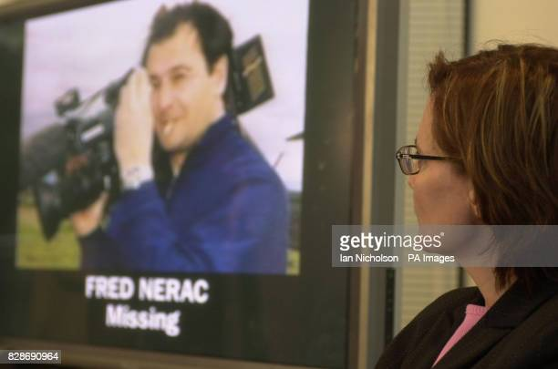 Fabienne Nerac wife of missing ITN cameraman Fred Nerac views a picture of her husband left on screen during a news conference where she called on...