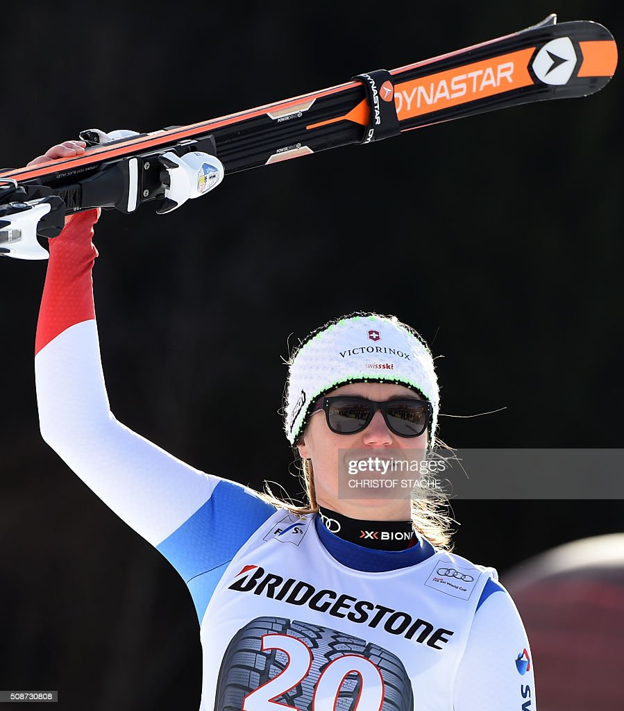 Fabienne Suter from Switzerland celebrates during the winner ceremony after the ladies downhill competition race at the FIS Alpine Skiing World Cup in Garmisch-Partenkirchen, southern Germany, on February 6, 2016. Lindsey Vonn from USA won the competition, Fabienne Suter from Switzerland placed second and Viktoria Rebensburg from Germany placed third. / AFP / Christof STACHE