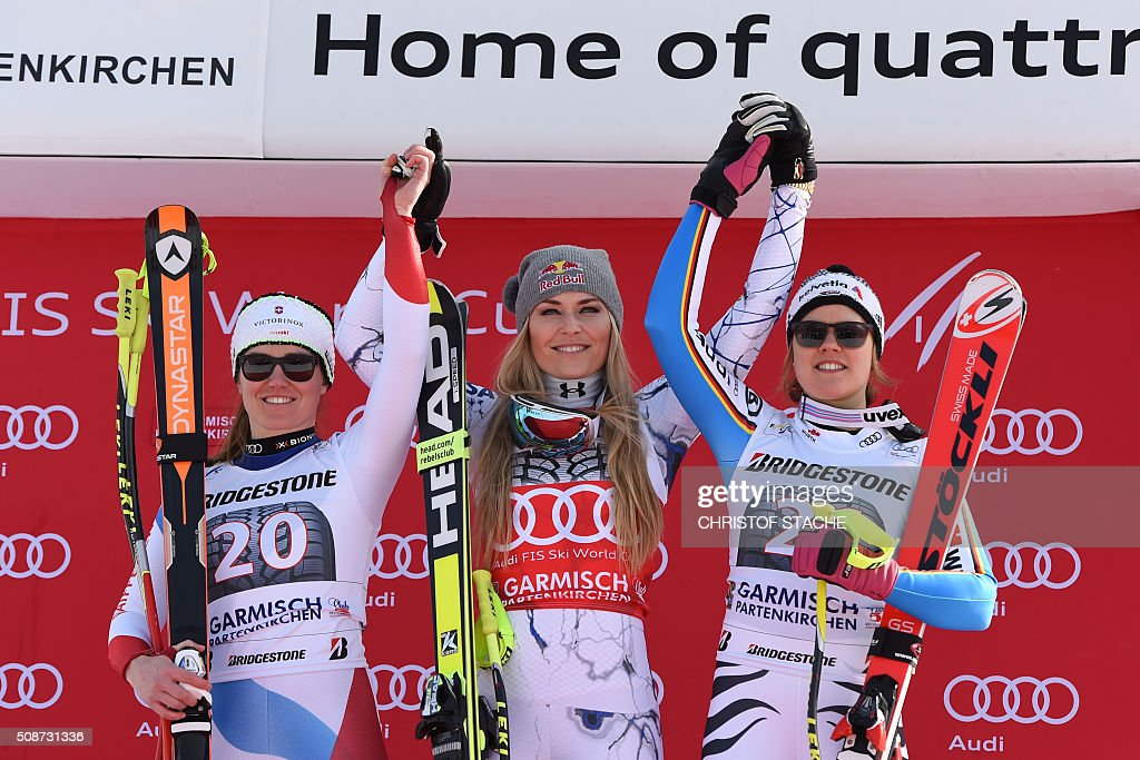 Fabienne Suter from Switzerland, Lindsey Vonn from USA and Viktoria Rebensburg from Germany pose during the winner ceremony after the ladies downhill competition race at the FIS Alpine Skiing World Cup in Garmisch-Partenkirchen, southern Germany, on February 6, 2016. Lindsey Vonn from USA won the competition, Fabienne Suter from Switzerland placed second and Viktoria Rebensburg from Germany placed third. / AFP / Christof STACHE