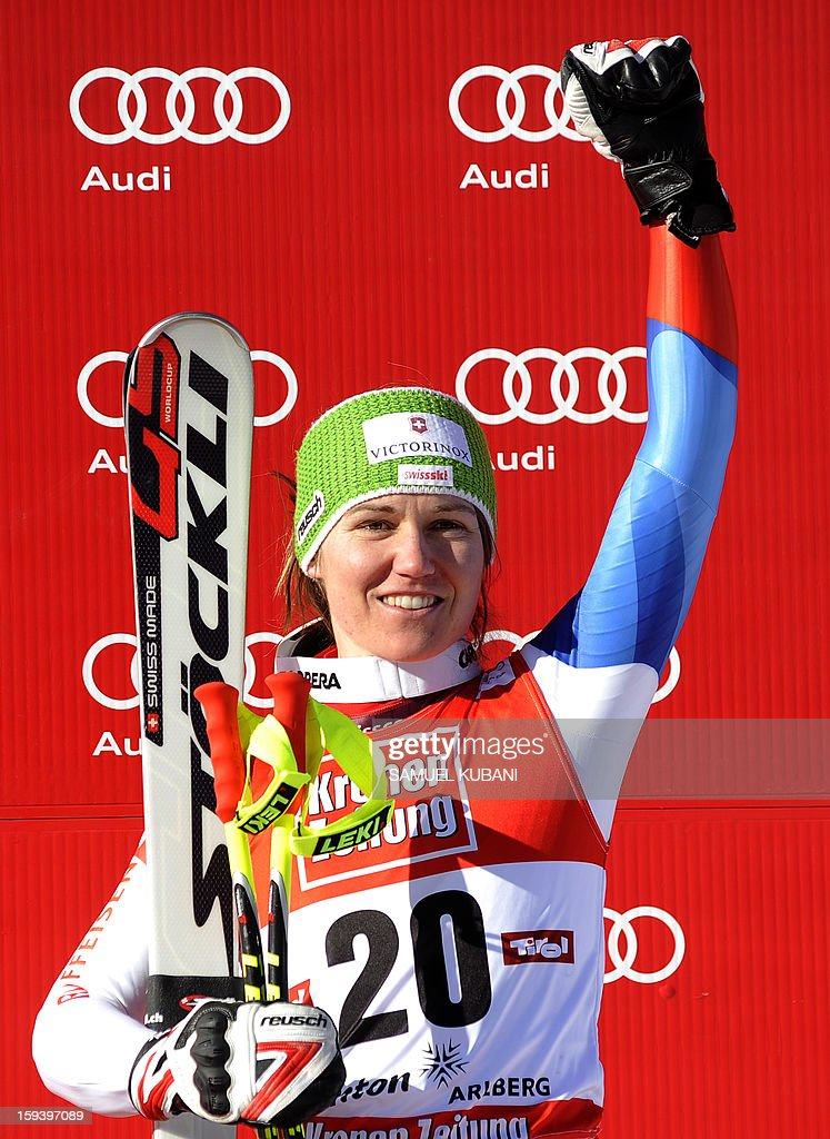 Fabienne Suter of Switzerland celebrates her third place on podium at the women's World Cup Super G January 13, 2013 in St Anton am Arlberg. Slovenian Tina Maze won the event ahead of Austrian Anna Fenninger and Fabienne Suter of Switzerland.