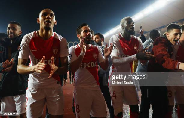 Fabinho Joao Moutinho and Tiemoue Bakayoko of AS Monaco celebrate victory after the UEFA Champions League Round of 16 second leg match between AS...