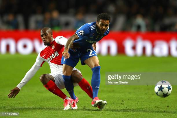 Fabinho of AS Monaco tackles Dani Alves of Juventus during the UEFA Champions League Semi Final first leg match between AS Monaco v Juventus at Stade...