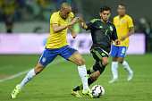 Fabinho of Brazil and Jesús Corona of Mexico compete for the ball during the International Friendly Match between Brazil and Mexico at Allianz Parque...