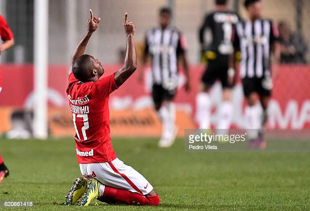 Fabinho of Internacional celebrates a scored goal against Atletico MG during a match between Atletico MG and Internacional as part of Copa do Brasil...