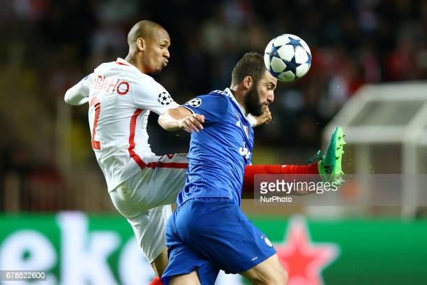 Fabinho of Monaco and Gonzalo Higuain of Juventus during the UEFA Champions League Semi Final first leg match between AS Monaco v Juventus at Stade...