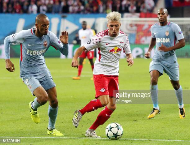 Fabinho of Monaco and Kevin Kampl of Leipzig battle for the ball during the UEFA Champions League group G match between RB Leipzig and AS Monaco at...
