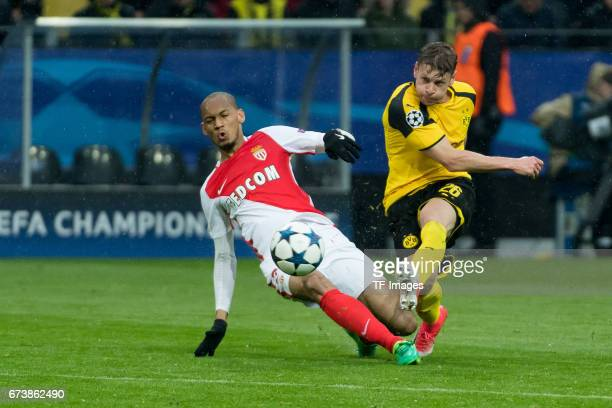 Fabinho of Monaco and Lukasz Piszczek of Dortmund battle for the ball during the UEFA Champions League Quarter Final First Leg match between Borussia...
