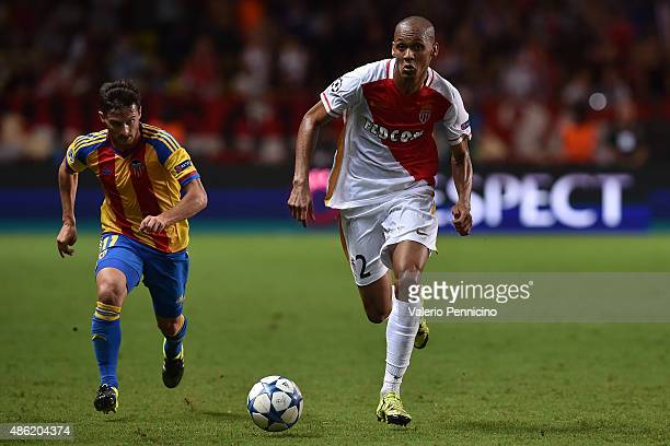 Fabinho of Monaco in action against Rodrigo of Valencia during the UEFA Champions League qualifying round play off second leg match between Monaco...