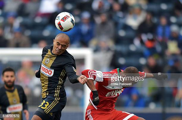 Fabinho of Philadelphia Union heads the ball away from Teal Bunbury of New England Revolution at Talen Energy Stadium on March 20 2016 in Chester...