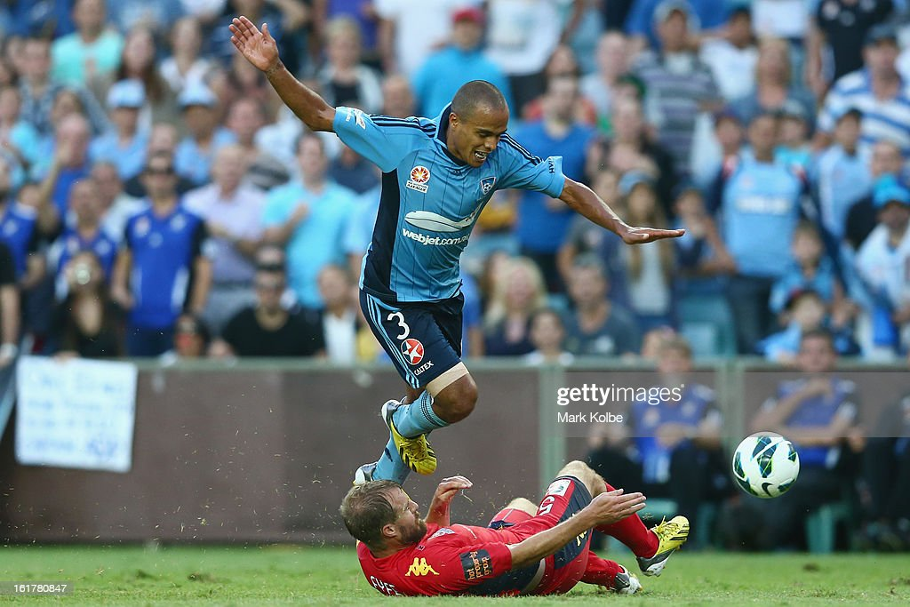 Fabio Alves of Sydney FC is tackled by Iain Fyfe of United during the round 21 A-League match between Sydney FC and Adelaide United at Allianz Stadium on February 16, 2013 in Sydney, Australia.