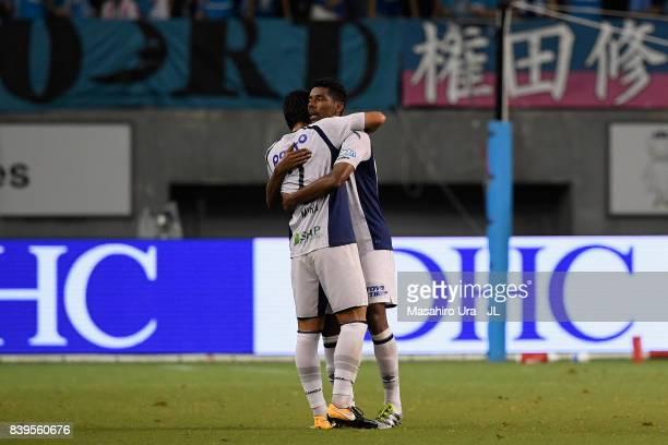 Fabio and Genta Miura of Gamba Osaka celebrate after their 31 victory in the JLeague J1 match between Sagan Tosu and Gamba Osaka at Best Amenity...