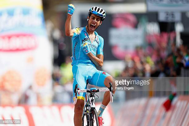 Fabio Aru of Italy and Astana celebrates crossing the fnish line to win the fifteenth stage of the 2014 Giro d'Italia a 225km high mountain stage...
