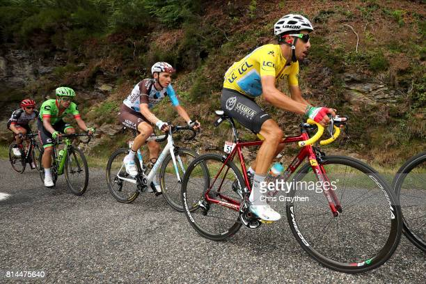 Fabio Aru of Italy riding for Astana Pro Team in the leader's jersey leads Romain Bardet of France riding for AG2R La Mondiale and Rigoberto Uran of...