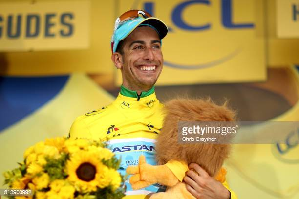 Fabio Aru of Italy riding for Astana Pro Team poses for a photo on the podium after taking the leader's jersey during stage 12 of the 2017 Le Tour de...