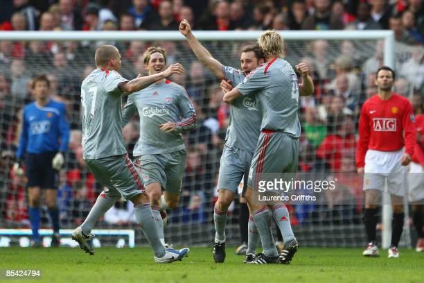 Fabio Aurelio of Liverpool celebrates scoring his team's third goal with his team mates during the Barclays Premier League match between Manchester...