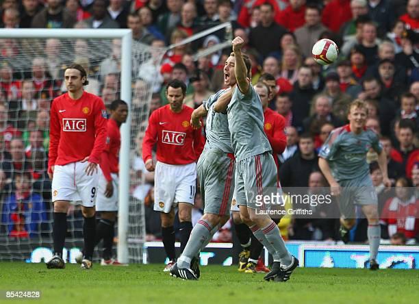 Fabio Aurelio of Liverpool celebrates scoring his team's third goal with team mate Steven Gerrard during the Barclays Premier League match between...