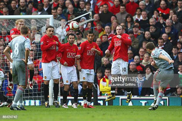 Fabio Aurelio of Liverpool scores his team's third goal during the Barclays Premier League match between Manchester United and Liverpool at Old...