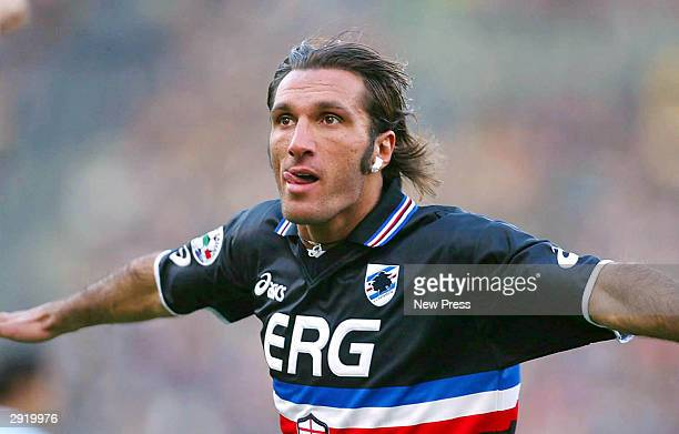 Fabio Bazzani of Sampdoria celebrates during the Serie A match between Lazio and Sampdoria at the Stadio Olimpico on February 1 2004 in Rome Italy