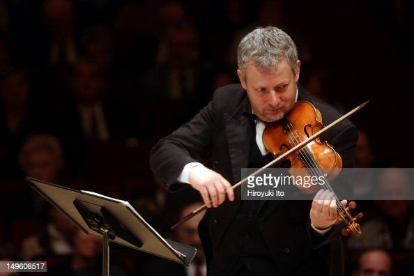 Fabio Biondi on violin standing leading the Stavanger Symphony Orchestra in the program of Vivaldi Bach Roman Haydn and Mozart at Carnegie Hall on...