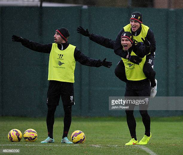 Fabio Borini Martin Skrtel and Dejan Lovren of Liverpool during a training session at Melwood Training Ground on December 12 2014 in Liverpool England