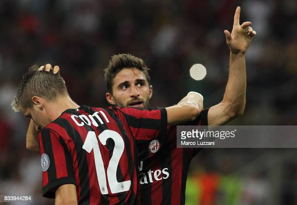Fabio Borini of AC Milan celebrates his goal with his teammate Andrea Conti during the UEFA Europa League Qualifying PlayOffs round first leg match...