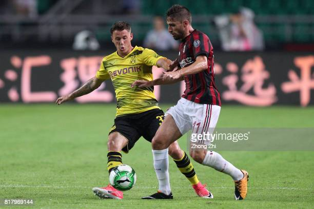 Fabio Borini of AC Milan in action against Erik Durm of Dortmund during the 2017 International Champions Cup football match between AC Milan and...