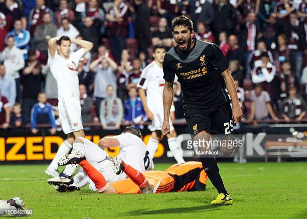 Fabio Borini of Liverpool celebrates after Andrew Webster of Hearts scored an own goal during UEFA Europa League playoff first leg match between...