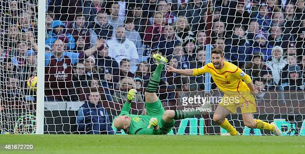 Fabio Borini of Liverpool celebrates after scoring the opening goal during the Barclays Premier League match between Aston Villa and Liverpool at...