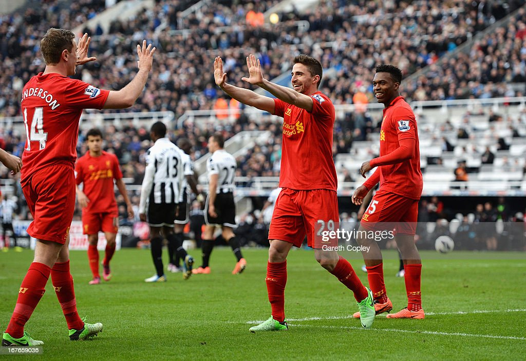 Fabio Borini of Liverpool celebrates scoring the fifth Liverpool goal with Jordan Henderson (L) and Daniel Sturridge during the Barclays Premier League match between Newcastle United and Liverpool at St James' Park on April 27, 2013 in Newcastle upon Tyne, England.