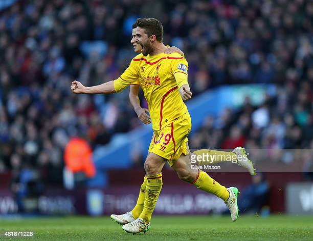 Fabio Borini of Liverpool celebrates scoring their first goal during the Barclays Premier League match between Aston Villa and Liverpool at Villa...
