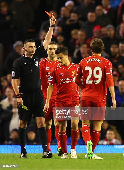 Fabio Borini of Liverpool is shown the red card by referee Michael Oliver during the Barclays Premier League match between Liverpool and Arsenal at...