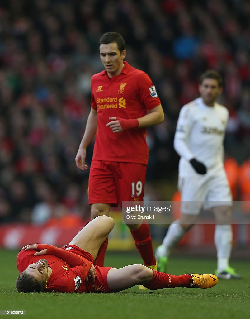 Fabio Borini of Liverpool lies injured after dislocating his shoulder during the Barclays Premier League match between Liverpool and Swansea City at Anfield on February 17, 2013 in Liverpool, England.