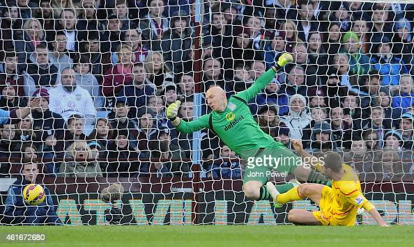 Fabio Borini of Liverpool scores the opening goal during the Barclays Premier League match between Aston Villa and Liverpool at Villa Park on January...