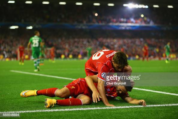 Fabio Borini of Liverpool tends to Javi Manquillo of Liverpool after he was brought down for a penalty during the UEFA Champions League Group B match...