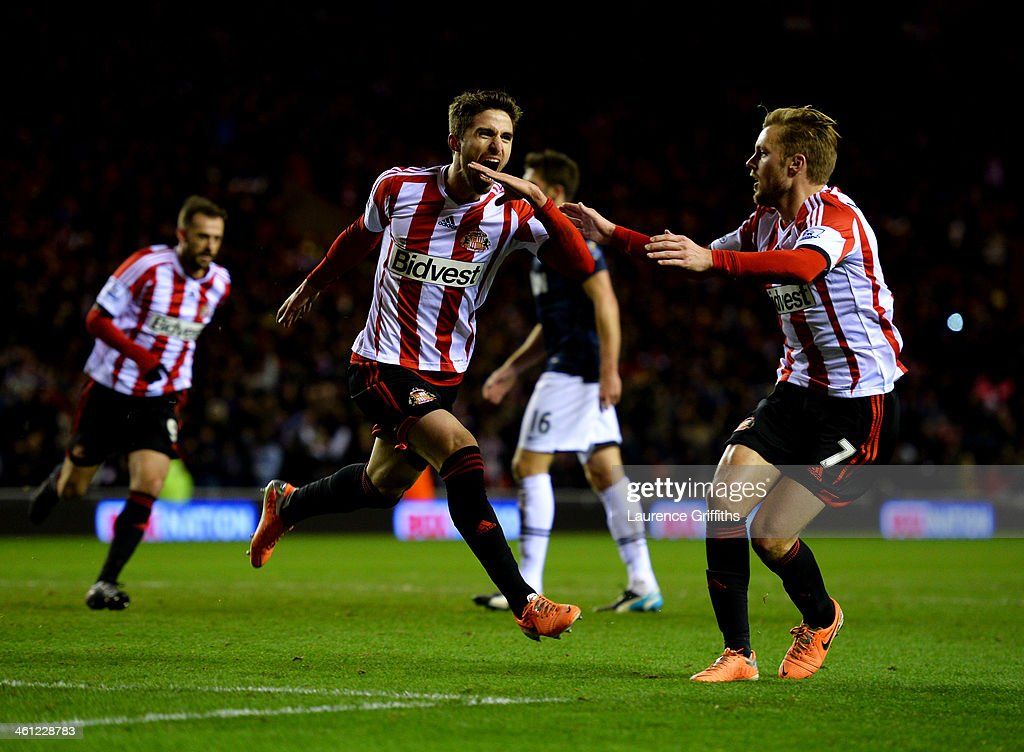 <a gi-track='captionPersonalityLinkClicked' href=/galleries/search?phrase=Fabio+Borini&family=editorial&specificpeople=5565045 ng-click='$event.stopPropagation()'>Fabio Borini</a> of Sunderland (C) celebrates with <a gi-track='captionPersonalityLinkClicked' href=/galleries/search?phrase=Sebastian+Larsson&family=editorial&specificpeople=719331 ng-click='$event.stopPropagation()'>Sebastian Larsson</a> (R) as he scores their second goal from the penalty spot during the Capital One Cup Semi-Final, first leg match between Sunderland and Manchester United at Stadium of Light on January 7, 2014 in Sunderland, England.