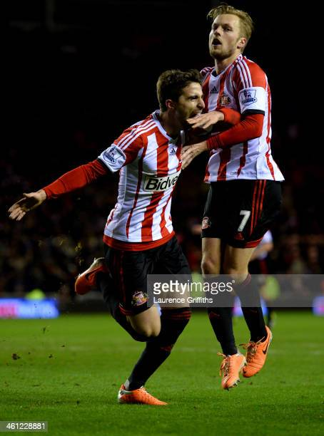 Fabio Borini of Sunderland celebrates with Sebastian Larsson as he scores their second goal from the penalty spot during the Capital One Cup...