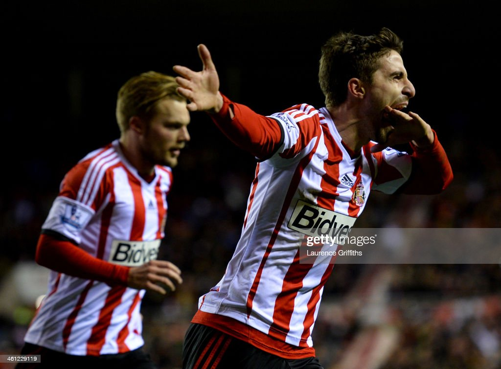 Fabio Borini of Sunderland (R) celebrates with Sebastian Larsson (L) as he scores their second goal from the penalty spot during the Capital One Cup Semi-Final, first leg match between Sunderland and Manchester United at Stadium of Light on January 7, 2014 in Sunderland, England.